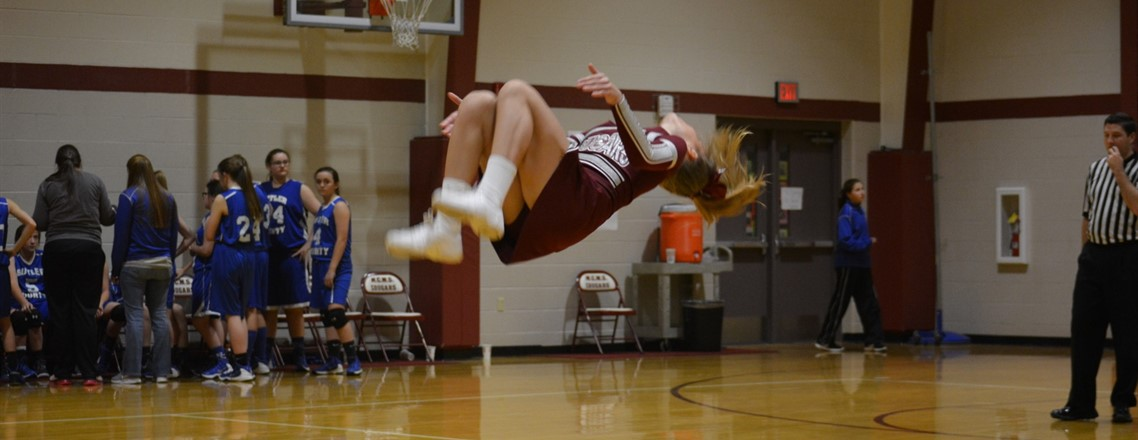 MCMS CHEERLEADER DOING A FLIP